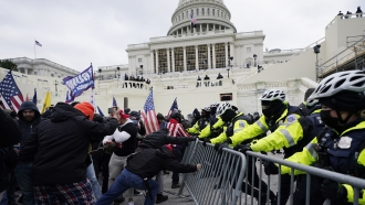 Rioters try to break through police barrier at US Capitol on Jan. 6.