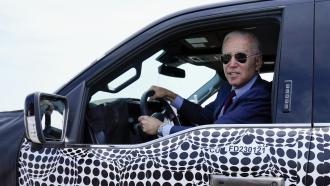 President Biden drives electric truck