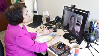 Psychologist Mary Alvord, left, holds a video conference with her colleague
