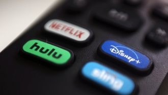 file photo, the logos for Netflix, Hulu, Disney Plus and Sling TV