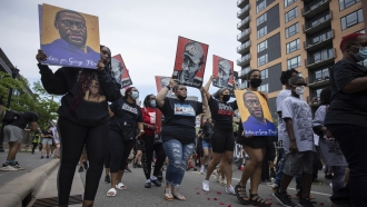 Family of Daunte Wright in a march commemorating the one year anniversary of George Floyd's death