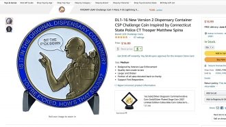A police misconduct souvenir coin for sale