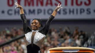 Simone Biles celebrates after competing in the vault during the U.S. Gymnastics Championships.