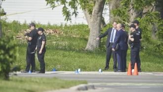 Police investigate the scene of a car crash in London, Ontario