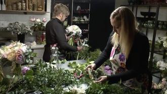 Women work in a flower shop.