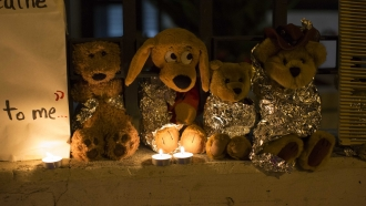 stuffed toy animals wrapped in aluminum foil representing migrant children separated from their families