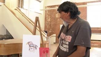Man looks at artwork