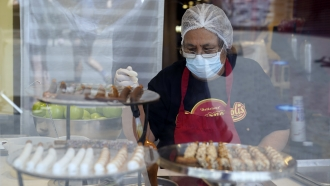 A worker at a shop in California