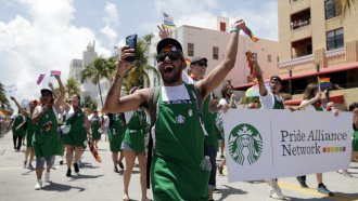 Starbucks employees in a Pride parade