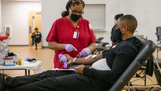 A man gives blood during a blood drive