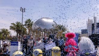 California Governor Gavin Newsom, center, celebrates after awarding $1.5 million checks to Vax for the Win lottery winners.