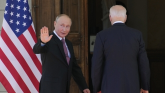Russian President Vladimir Putin, left, and U.S President Joe Biden enter the 'Villa la Grange' in Geneva