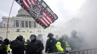 U.S. Capitol Police officers hold off rioters loyal to President Donald Trump at the Capitol in Washington.