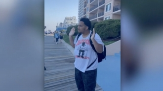 Teenager with his hands up on the Ocean City Boardwalk moments before police Tased him.