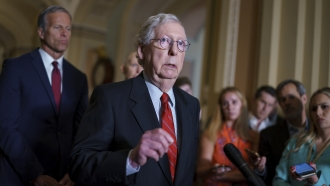 Senate Minority Leader Mitch McConnell talks to reporters.