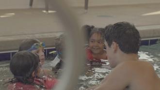 Kids swim in a pool