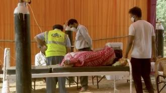 Woman lies on a stretcher.