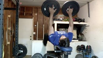 Man lifts weights.