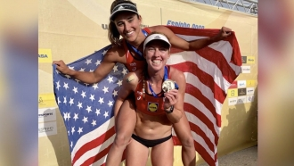 Women show their medals.