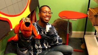 Actor Brian Harrison with puppet