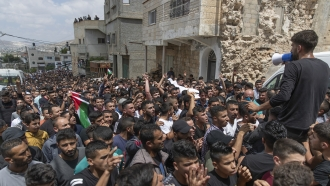 Palestinians mourn a 15-year-old boy killed by Israeli soldiers during protests in the occupied West Bank