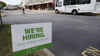 A We're Hiring sign at a Publix supermarket in Richmond, Virginia