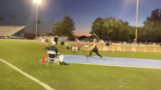 Woman throws a javelin.