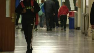 Students walk in a school hallway