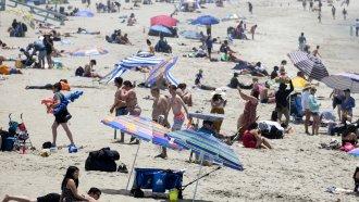 Beachgoers crowd in the heat at Santa Monica Beach on Wednesday, June 16, 2021, in Santa Monica, Calif.