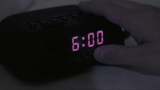 Man turns off an alarm.