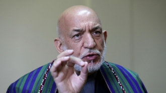 Former Afghan President Hamid Karzai speaks during an interview to the Associated Press in Kabul, Afghanistan.