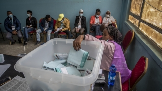Electoral workers continue to count votes at a polling station in the capital Addis Ababa, Ethiopia.