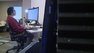 Man works on a computer.