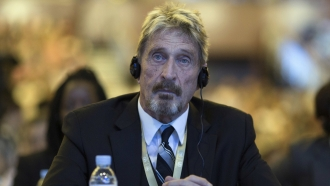 John McAfee listens during the 4th China Internet Security Conference in 2016.