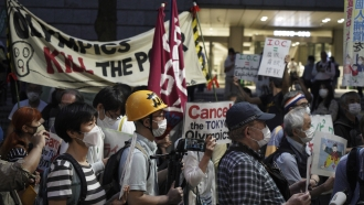 Protesters in Tokyo March Against the Upcoming Olympics