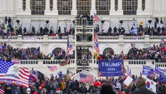 Insurrectionists loyal to President Donald Trump breach the Capitol in Washington, DC
