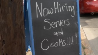 Help wanted sign outside.
