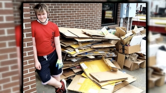 Man poses by boxes.