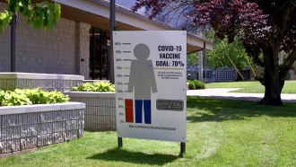 A sign in Springfield, MO shows the county's covid-19 vaccination rate.