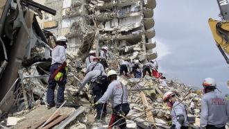 Rescue crews search for survivors in rubble