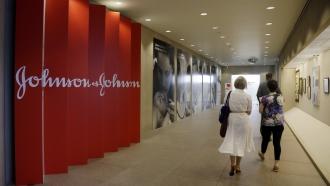 People walk along a corridor at the headquarters of Johnson & Johnson