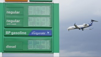 Gas prices are displayed as a jet descends to land at Cleveland Hopkins International Airport in Cleveland