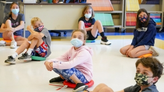 In this May 18, 2021 file photo, fifth graders wear face masks