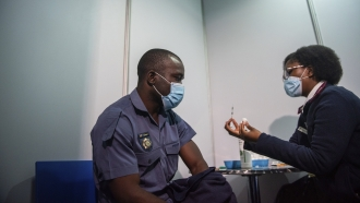 A policeman receives his J&J COVID-19 vaccine in Soweto, South Africa.