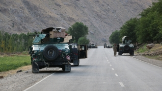 Afghan soldiers in vehicles pause on a road in northern Afghanistan.