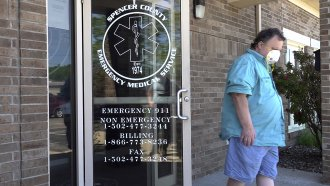 A visitor to a clinic leaves after receiving a COVID-19 vaccine in Taylorsville, Ky.