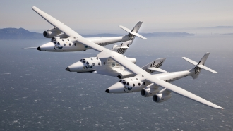 VMS Eve and SpaceShipTwo fly over the San Francisco Bay