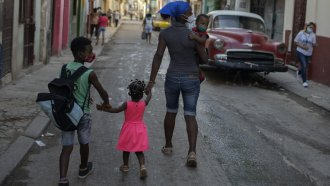 A Cuban family walks through Havana