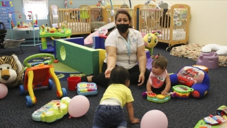 Teacher working with infants