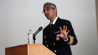 Surgeon General Vivek Murthy speaks at a ceremony honoring care workers